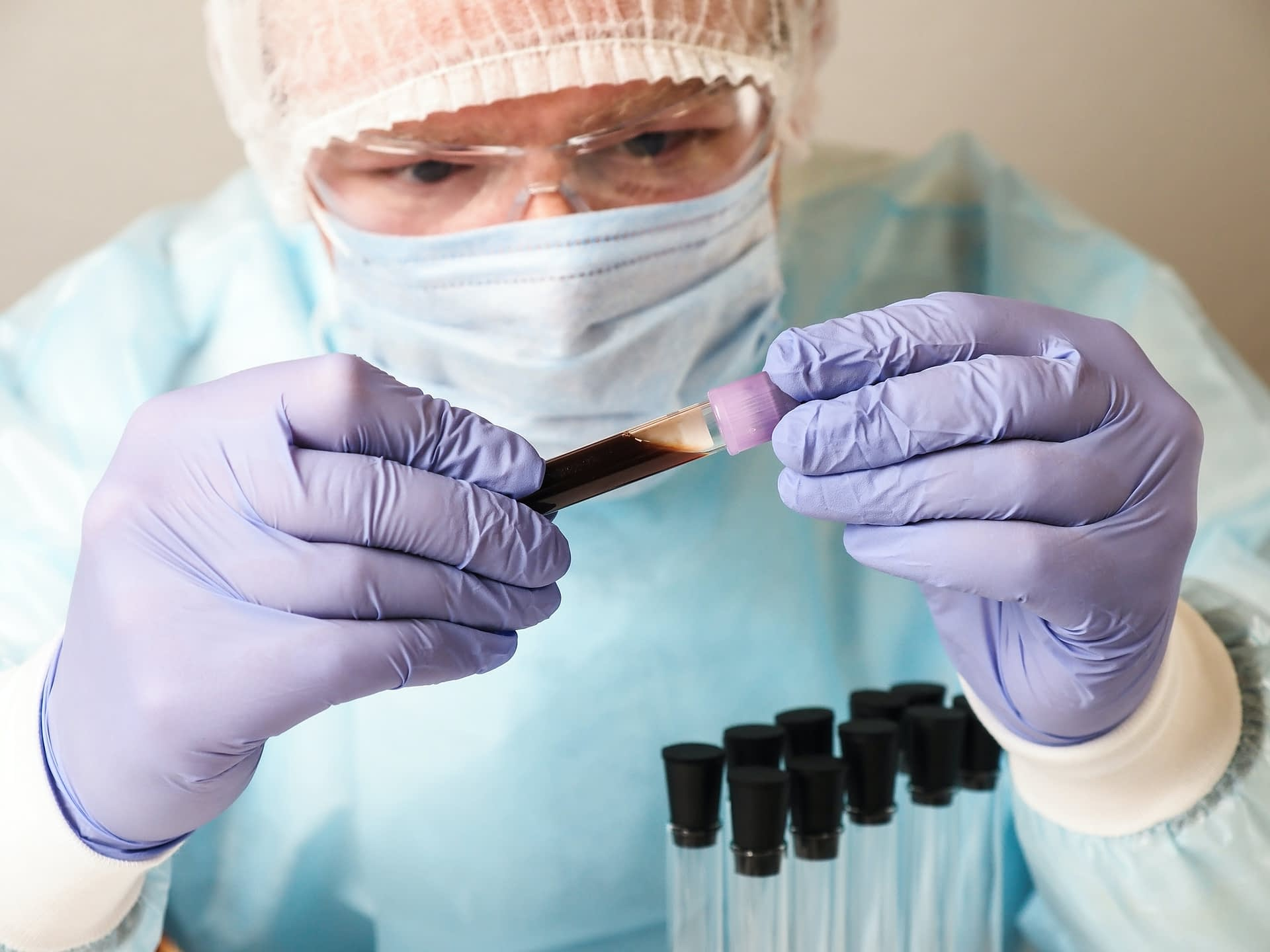Medical laboratory specialist with a test tube